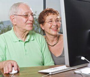 senior couple using an imac computer